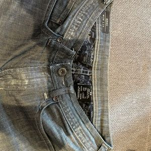 Men's jeans length is 38 inches from waist to hem.